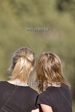 2 Girls Looking In Saskatchewan Canada Teens Teenagers Stock Photo