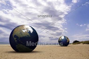 3d Blue Earth On A Beach Stock Photo