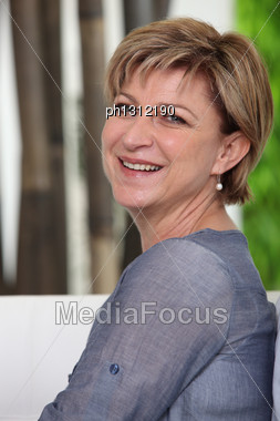 50 Years Old Lady Smiling Stock Photo