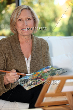 50 Years Old Woman Painting Stock Photo