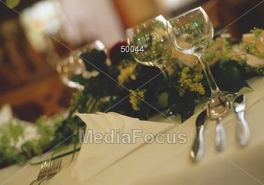 setting plates glasses Stock Photo
