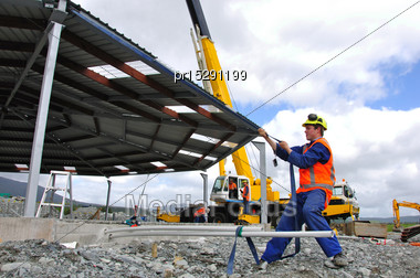 70 Tonne Crane Lifts The Roof Onto A New Dairy, Westland, New Zealand Stock Photo
