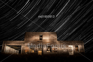 Abandoned Building And Star Trails Saskatchewan Canada Stock Photo