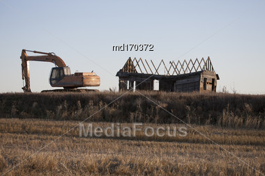 Abandoned Buildings Saskatchewan Rural Back Hoe Stock Photo