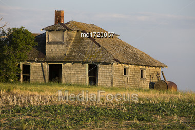Abandoned Farm Buildings In Saskatchewan Canada Weathered Stock Photo