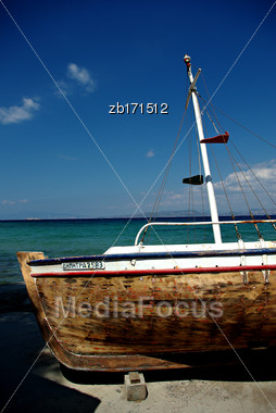 Abandoned Fishing Wooden Rowboat At Seaside At Sunny Summer Day Stock Photo