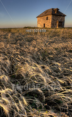 Abandoned Stone House At Sunset Saskatchewan Canada Stock Photo