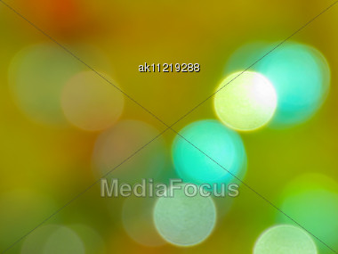 Abstract Background. Bokeh In A Green-orange Palette Stock Photo