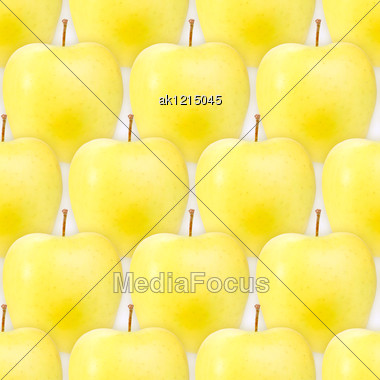 Abstract Background Of Fresh Yellow Apples. Seamless Pattern For Your Design. Close-up. Studio Photography. Stock Photo
