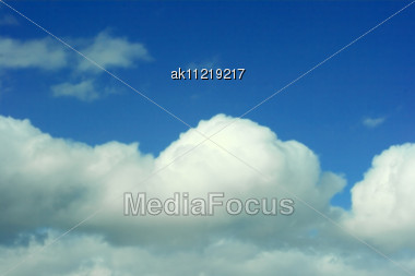 Abstract Background From White Clouds And Blue Sky Stock Photo