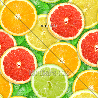 Abstract Background With Motley Citrus-fruit Slices And Green Leaf With Dew. Seamless Pattern For Your Design. Close-up. Studio Photography. Stock Photo