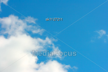 Abstract Background With White Clouds And Blue Sky Stock Photo