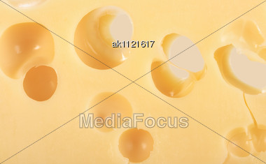 Abstract Background Of Yellow Cheese. Close-up. Studio Photography Stock Photo