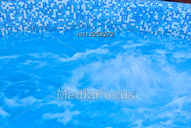 Abstract Blue Water Background Of Hot Whirlpool Stock Photo