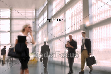 Abstract Image Of A Business People Activity In The Lobby In Intentional Motion Blur And A Reddish Tint Stock Photo
