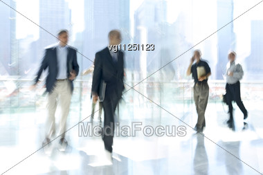 Abstract Image Of A Business People Activity Standing And Walking In The Lobby,person Talking On The Mobile Phone Stock Photo
