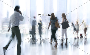 Abstract Image Of A Business People Activity Standing And Walking In The Lobby, Backlit Light From A Window And Intentional Blur And Tint Stock Photo
