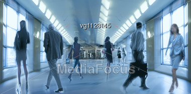 Abstract Image Of A Business People Standing In The Lobby In Intentional Motion Blur And A Blue Tint Stock Photo