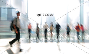 Abstract Image Of A Business People Standing In The Lobby In Intentional Motion Blur And A Tint Stock Photo