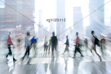 Abstract Image Of A Crowd Of People Standing In The Lobby In Intentional Motion Blur And A Blue Tint Stock Photo