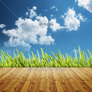 Abstract Natural Backgrounds With Wooden Desk And Green Grass Under Blue Skies Stock Photo