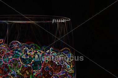Abstract Of Neon Beads In A Glass Stock Photo