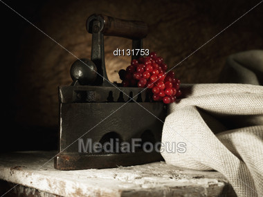 Abstract Retro Still Life With Vintage Iron And Hessian Textile Stock Photo