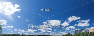 Abstract Urban Panorama With Residential Buildings And Blue Skies Stock Photo