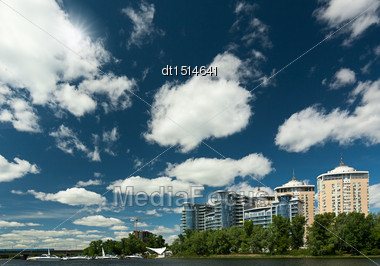 Abstract Urban View With Residential Buildings, Yaht Club And Blue Skies Stock Photo