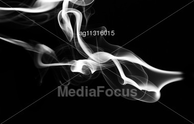 Abstract White Fume Pattern And Shape Over Black Background Stock Photo