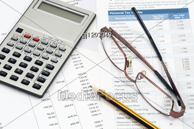 Accountant Work Space. Statement,calculations And Expenses Stock Photo