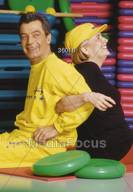 Active Couple Exercising Stock Photo