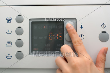 Adjusting Wash Settings On The Control Panel Of Washing Machine Stock Photo