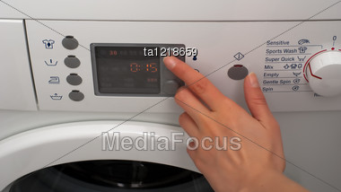 Adjusting Wash Temperature On The Control Panel Of Washing Machine Stock Photo