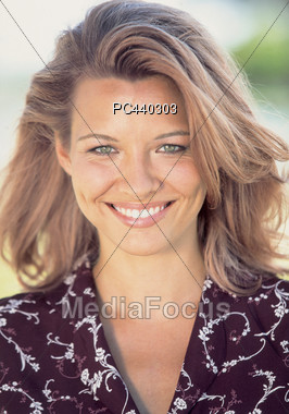 Adult Blonde Woman Smiling Stock Photo
