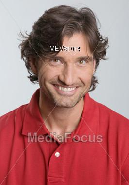 Adult Man With Dark Wavy Hair Stock Photo