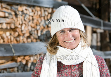 Adult Woman Outside With White Wool Cap & Scarf Stock Photo