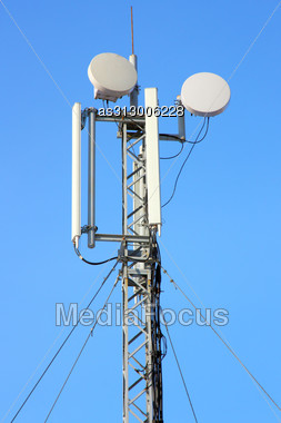Aerial Mobile Communication Against The Blue Sky Stock Photo