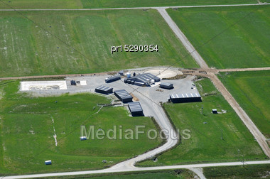 Aerial Of Typical Dairy Farm Set In The Midst Of Humped And Hollowed Paddocks, Westland, New Zealand Stock Photo
