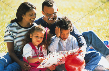 African American Family Reading Stock Photo