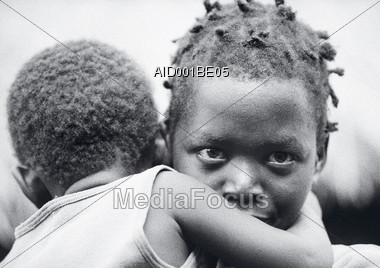 African-American Girl Carrying Child Stock Photo