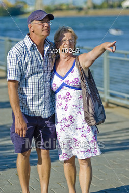Aged Loving Couple Walking And Holding Each Other Stock Photo