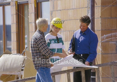 Agent or Builder with Clients Stock Photo