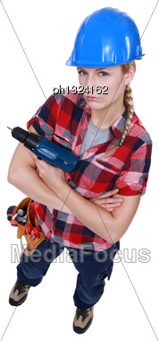 Aggressive Female Builder Holding Drill Stock Photo
