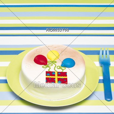 lit cake candle Stock Photo