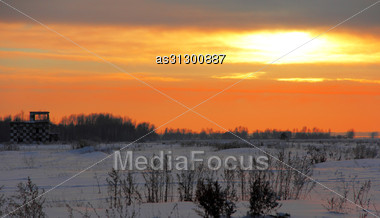 Airfield In Front Of A Winter Sunset In Snow Stock Photo