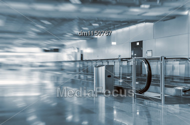 Airport Interior With Escalator. Motion Blur Stock Photo