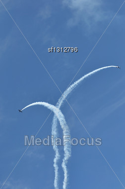 Airshow Small Airplanes In A Blue Sky Stock Photo