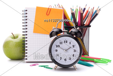 Alarm Clock, Blank Notebook Sheet And Apple. Schoolchild And Student Studies Accessories. Back To School Concept Stock Photo