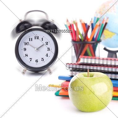 Alarm Clock, Notebook Stack And Pencils. Schoolchild And Student Studies Accessories. Back To School Concept Stock Photo